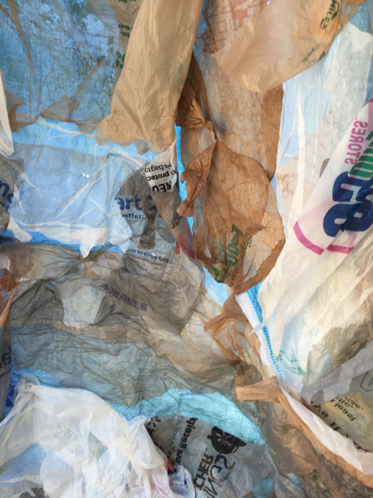 Shopping bags attached to the found tarp